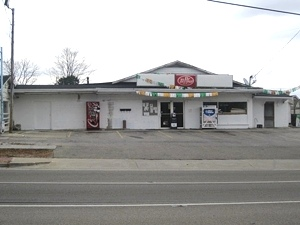 SOLD! INCOME PRODUCING! Convenient store w/gas pumps & 66 storage units, rental space. $261,000