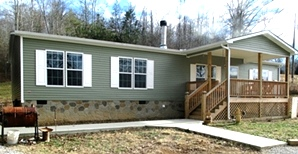 2694 Buck Creek Road | : 28'X60' KABCO doublewide located on 19 acres +/-. 4 bedrooms, 2 baths