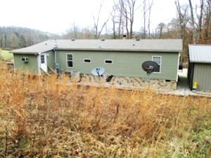 2694 Buck Creek Road   : 28'X60' KABCO doublewide located on 10 acres +/-. 4 bedrooms, 2 baths