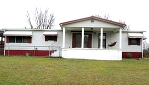 5280 S Hwy 25w, Wmsbg |Large fenced lot, 1990 26' X 54 double wide, 3 bedrooms, 2 baths, kitchen, large living room w/fireplace,