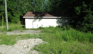 .267 +/- acres located on Old Corbin Pike with a 28'X32' building that has electric and insulation in the walls