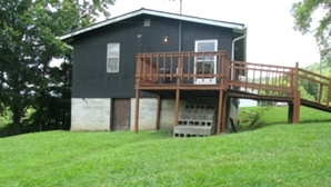 860 Harps Ck. | 864 sf +/- home on 1.5 acres. Living rm., two bedrooms, eat-in-kitchen, one bath w/ laundry hook ups.