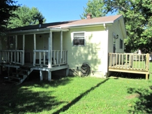 1644 Bethel  Rd. Pine Knot:     A 784 SF+/-  vinyl sided home with two bedrooms, living room, eat-in-kitchen,