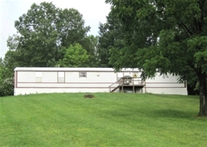242 Logan Rd., Corbin |  Home in the country! 1.2  acres and a 1999 16 X 80, 3 bdrm., 2 bath mobile home