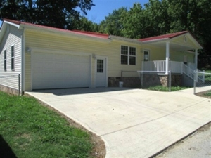 101 Graham Street:|  A newly remodeled 1252 SF +/- vinyl sided one story home on .24 acres +/-